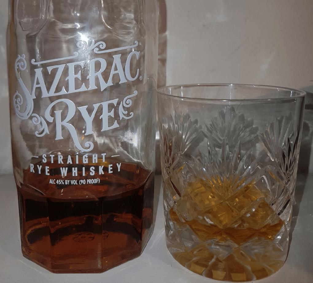 A bottle and glass of sazerac Rye Whiskey