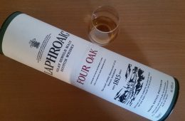 A bottle and glass of Laphroaig Four Oak