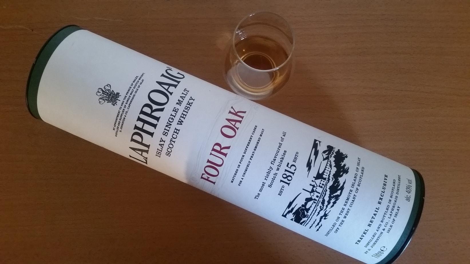 A bottle and glass of Laphroaig Four Oak
