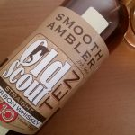 A bottle and glass of Smooth Ambler Old Scout 10