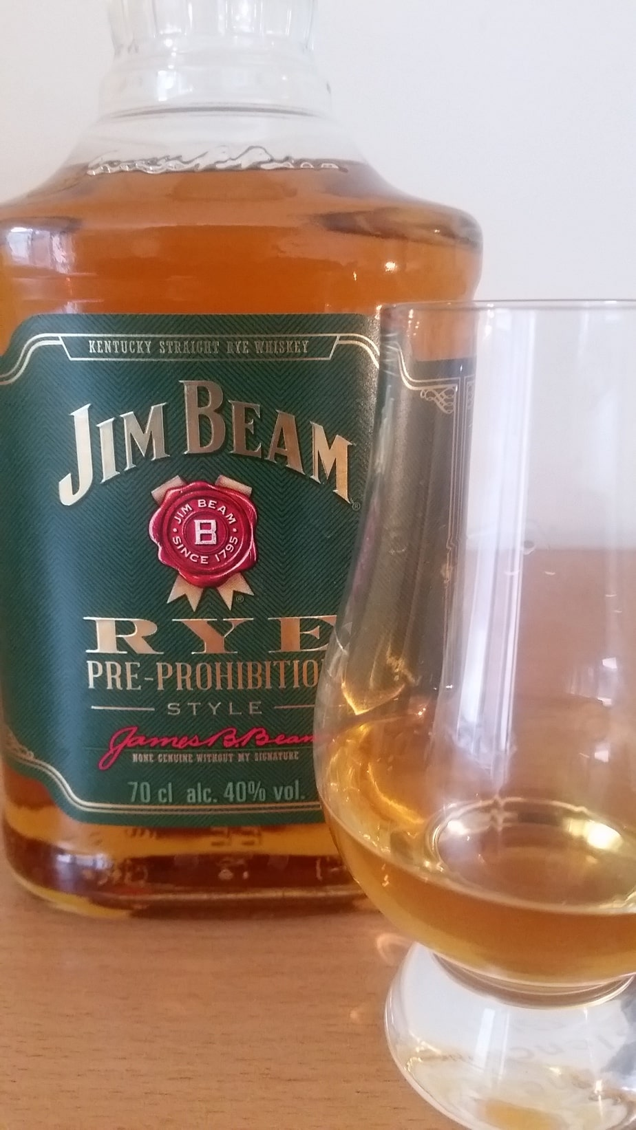 A close up of a bottle and glass of Jim Beam Pre Prohibition Rye