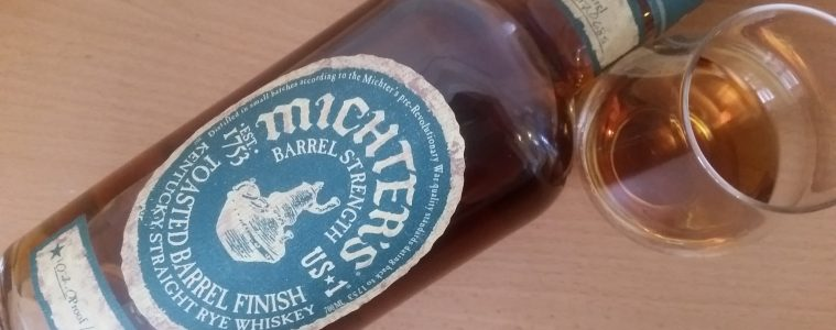 A bottle and glass of Michter's Barrel Toasted Rye