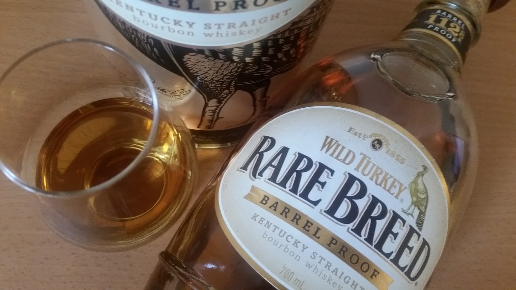 A bottle and glass of Wild Turkey Rare Breed