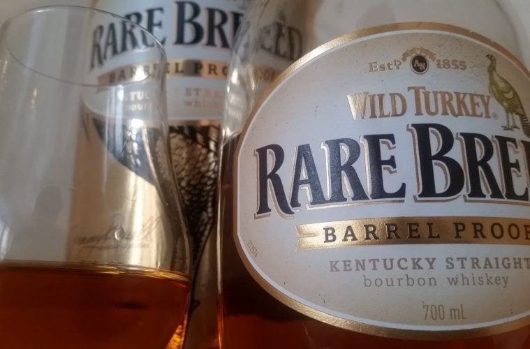 A closeup bottle and glass of Wild Turkey Rare Breed