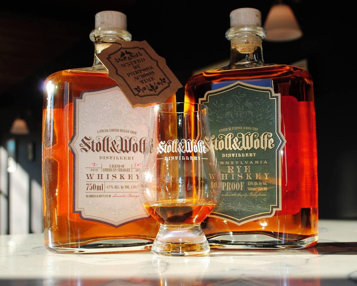 Two bottles of Stolle and Wolfe whiskey