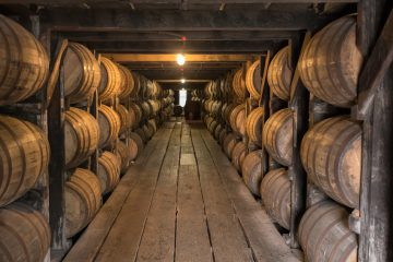 Whiskey barrels in a warehouse