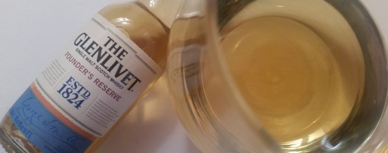 A mini bottle and glass of The Glenlivet Founders Reserve