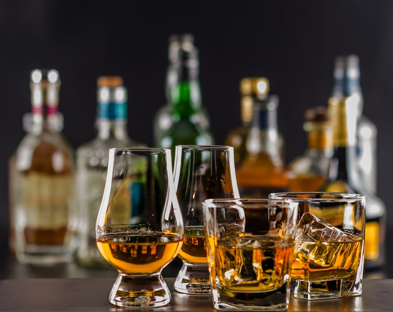 Several different whiskies on a bar