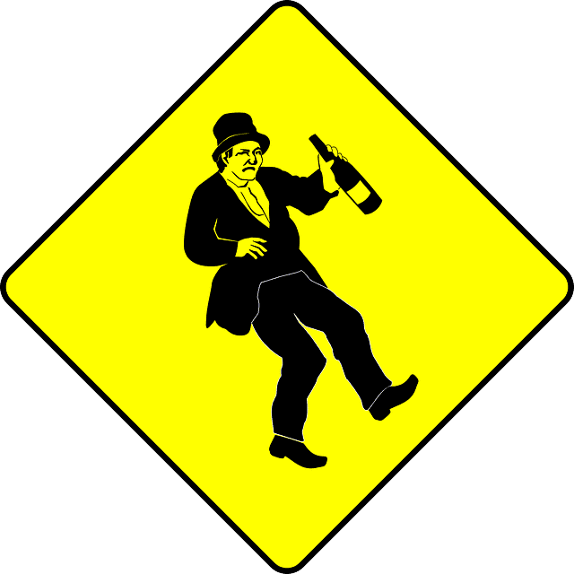 A yellow sign with a drunk man on it