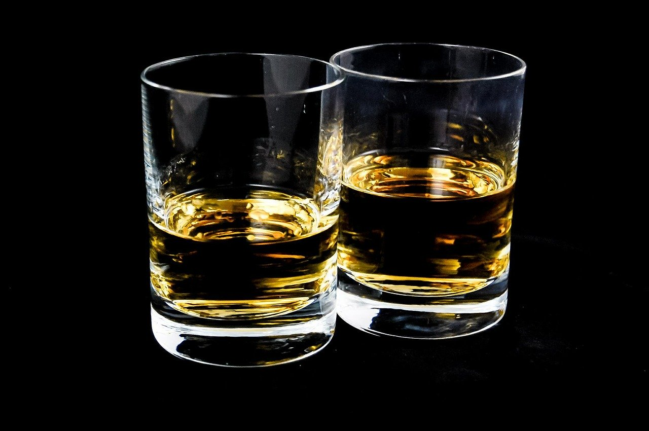 Two glasses of straight whisky