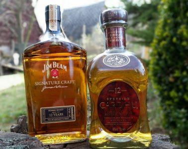 A bottle of Jim Beam whiskey next to Cardhu whisky