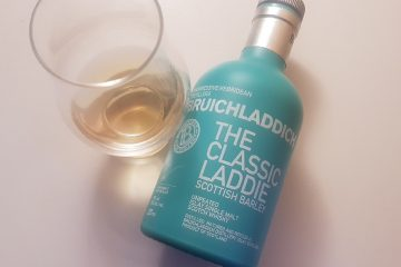 A bottle and glass of Bruichladdich The Classic Laddie