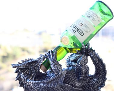 A dragon drinking a bottle of whisky