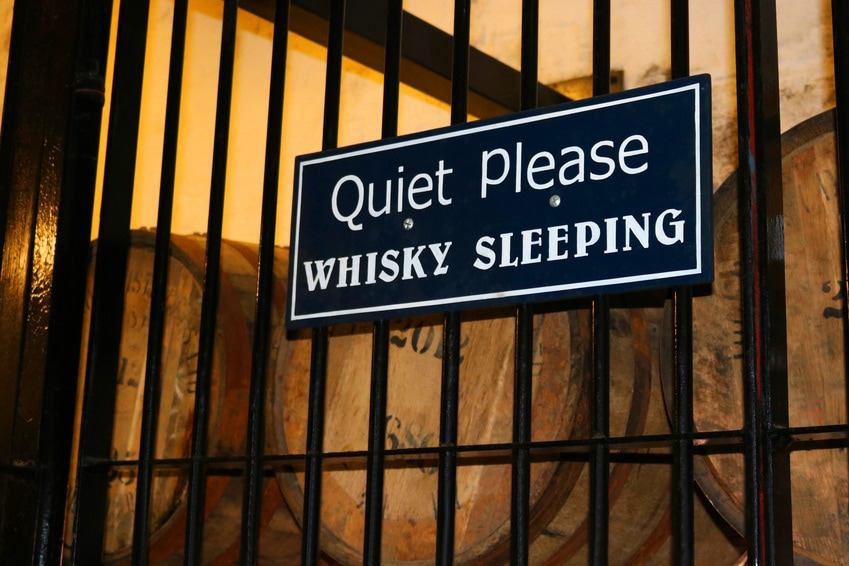 "Barrels with a ""Quiet Please Whisky Sleeping"" Sign"