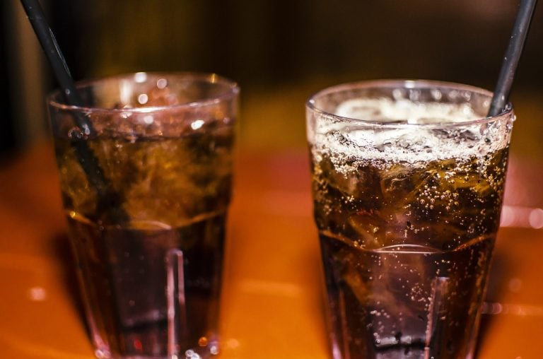 Two glasses of whiskey and soda