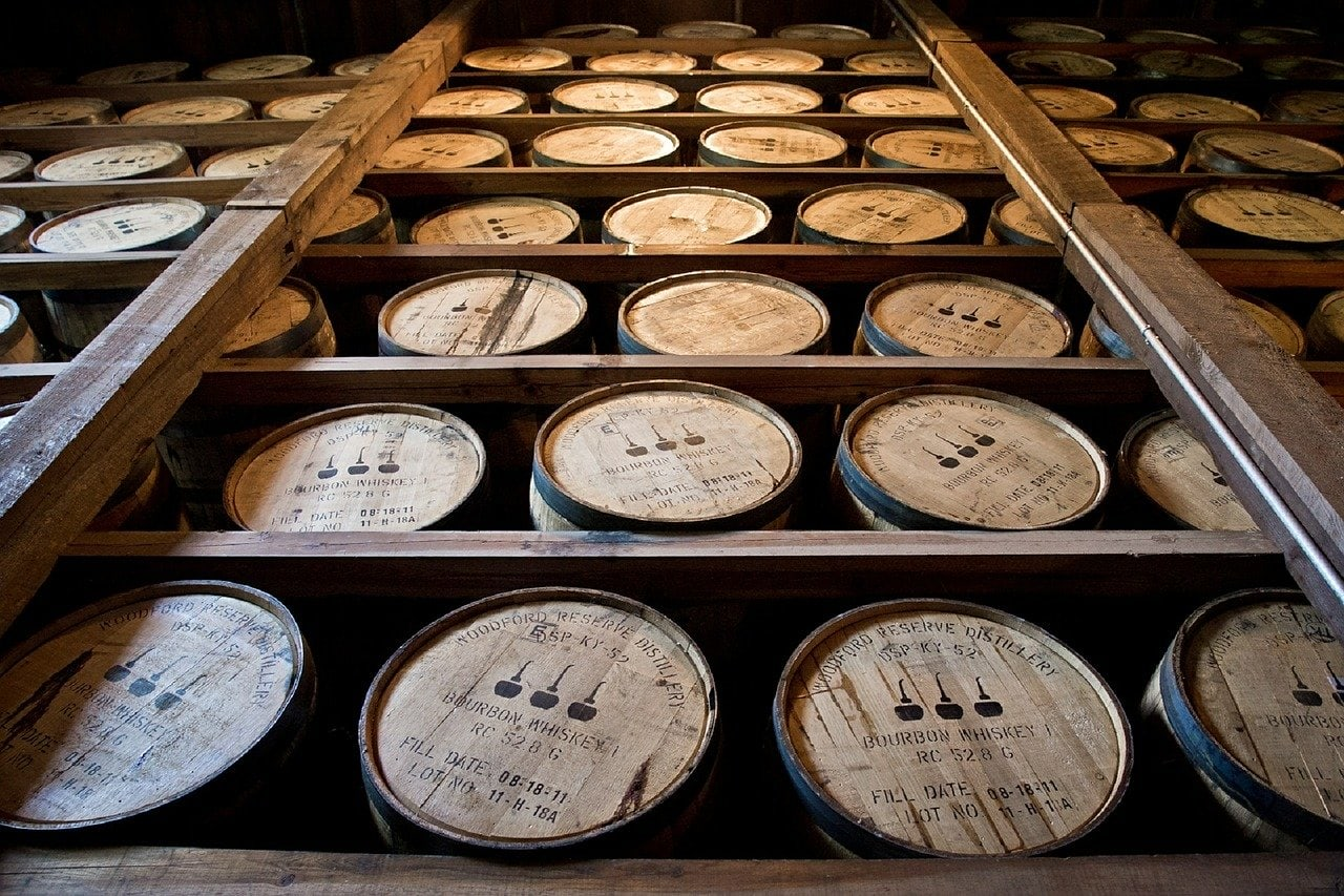 Barrels of whiskey on shelves