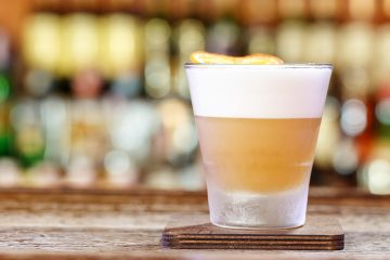 A whiskey sour on a bar