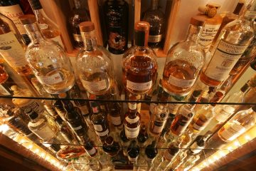 Scotch whisky bottles in a cabinet