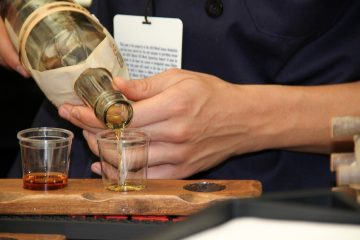 A man pouring whiskey shots