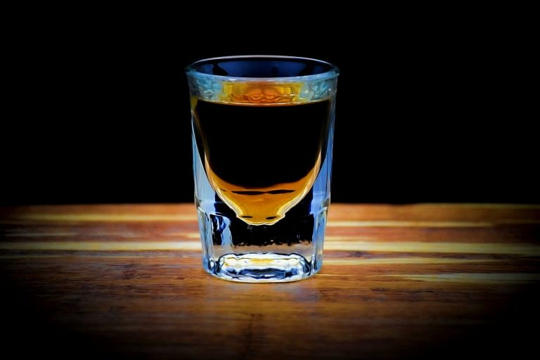 A shot of whiskey on a table