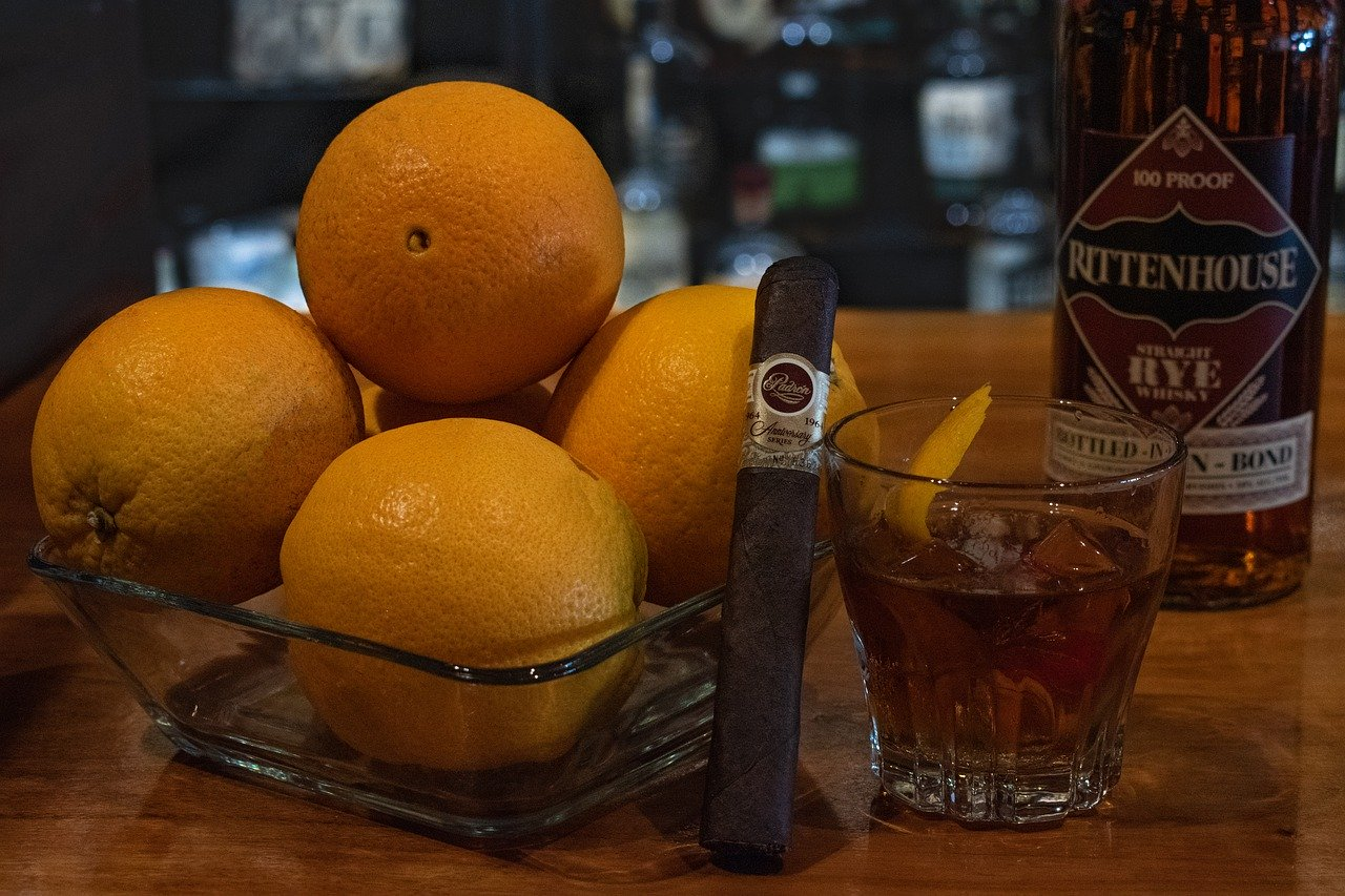 A bottle of Rittenhouse Rye and a cigar