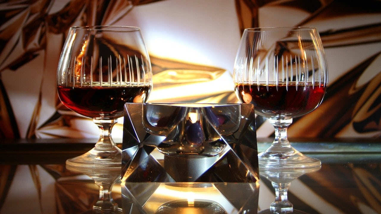 Two glasses with whiskey and Cognac in