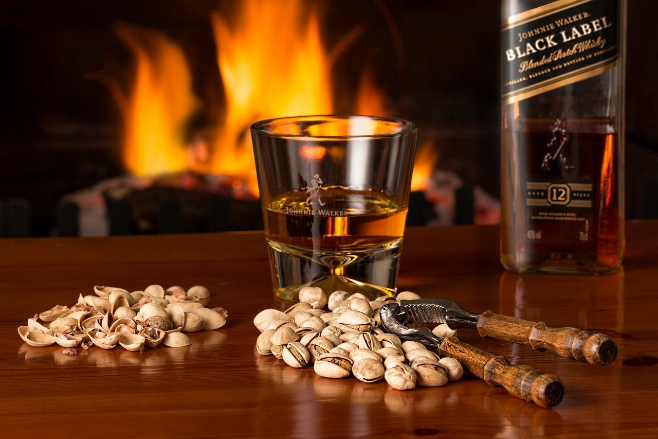A bottle and glass of Johnniw Walker Black Label blended whisky