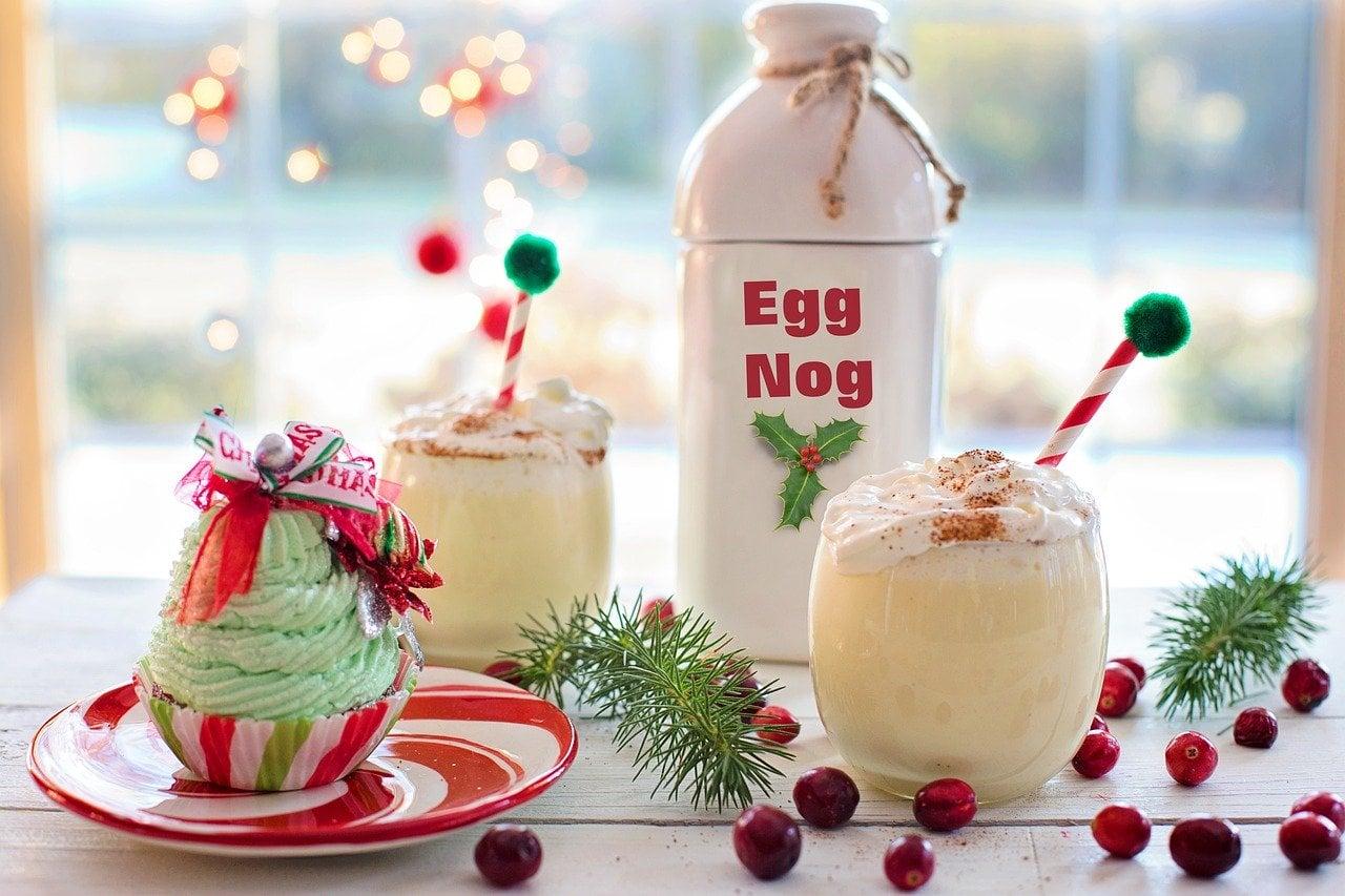 Bottle and glasses of eggnog