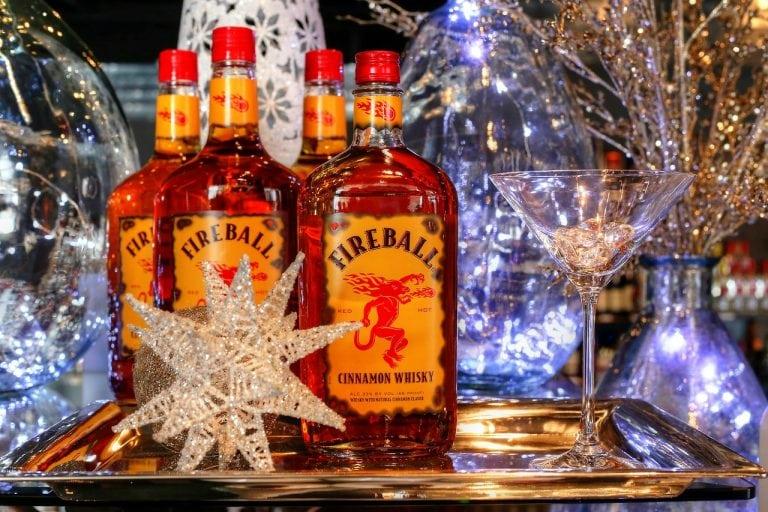 Bottles of Fireball next to a cocktail glass