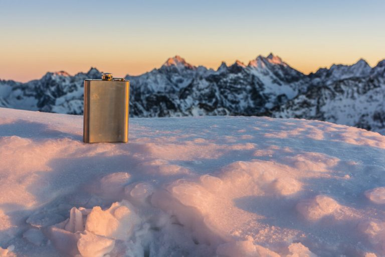 A flask of whiskey on a mountain